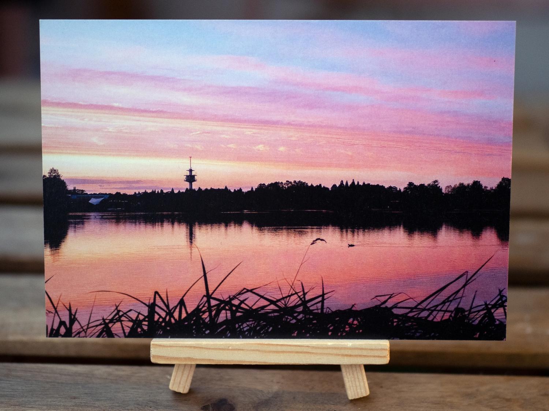 Ansichtskarte Abenddämmerung am Flückiger See/Seepark Motiv